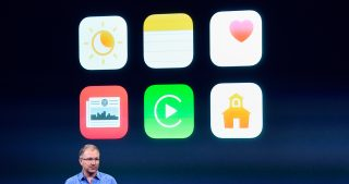 Greg Joswiak, vice president of iPod, iPhone, and iOS product marketing for Apple Inc., speaks during an Apple event in Cupertino, California, U.S., on Monday, March 21, 2016. Apple Inc. Chief Executive Officer Tim Cook is expected to unveil a smaller iPhone Monday in attempt to woo those who are holding on to older versions. Photographer: David Paul Morris/Bloomberg *** Local Caption *** Greg Joswiak